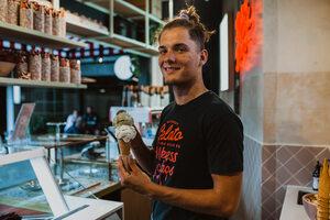 Island Gelato serving gelato scoop with a smile